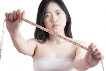 Woman measuring obese isolated on white background. Clipping path on white background.