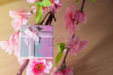 Gift box wrapped and plum blossom Christmas and Newyear presents with bows and ribbons, Christmas frame boxing day background and banner.