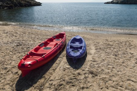 two plastic kayak on beach
