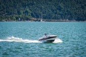 white motor yacht sailing in blue sea