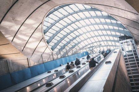 LONDON, UK - MARCH, 2016: People moving up on elevator, Canary Wharf Underground Station.