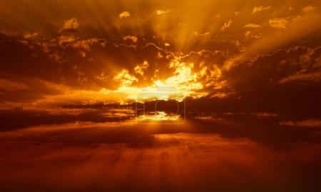 Photo for Nature background with golden sunbeams in clouds - Royalty Free Image