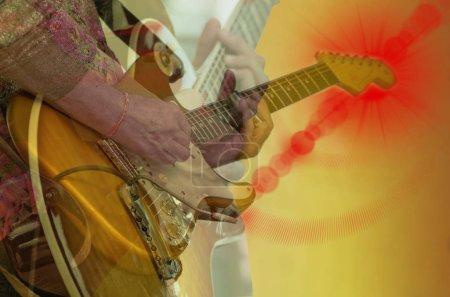 musician playing yellow guitar