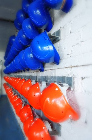 safety helmets hanging on wall