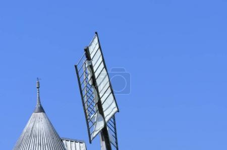 windmill on blue clear sky