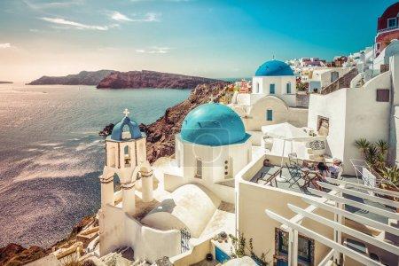 Santorini blue dome churches on sunny summer day, Greece