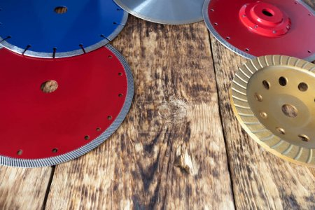 Diamond discs for concrete, reinforced concrete, granite and stone on the background of a wooden old board