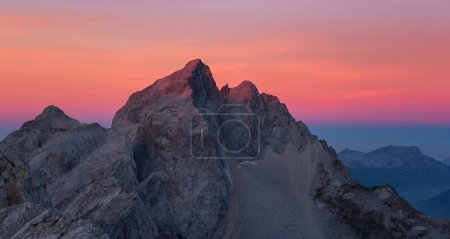 Mount Jalovec at sunrise glows