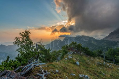 Vivid sunrise in the mountains with clouds
