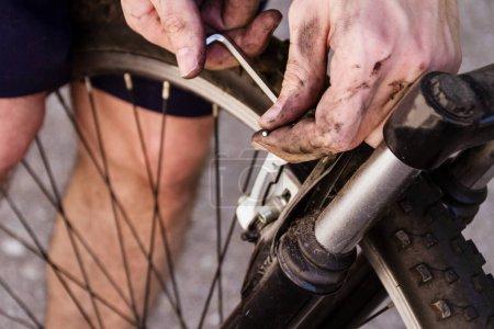 man repair bike