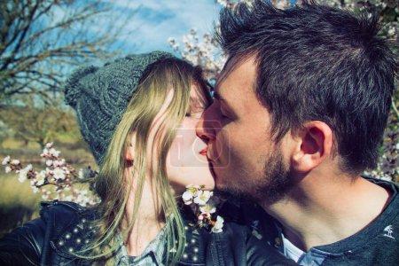 woman and man kissing