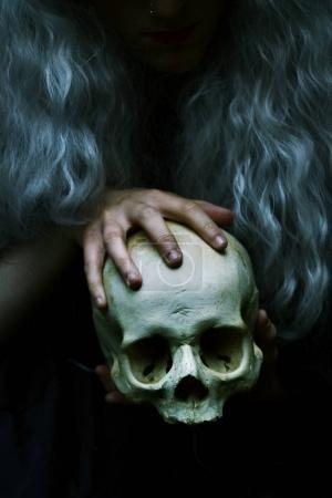 blonde woman with skull