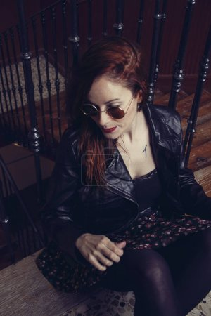 red hair woman with sunglasses
