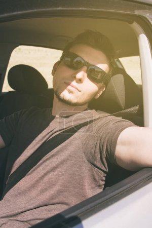 man with sunglasses enjoying summer