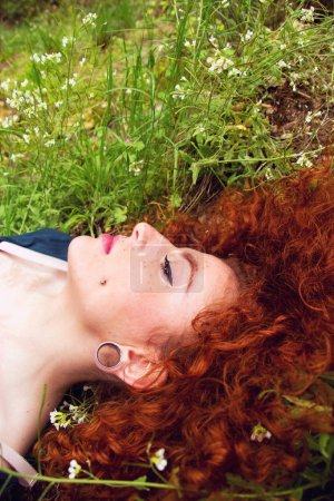 red hair woman with piercings