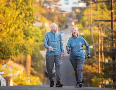 Happy couple walking on street