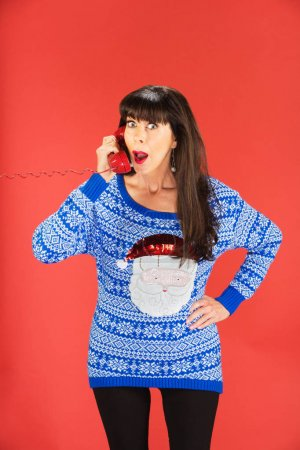 Surprised woman on red telephone