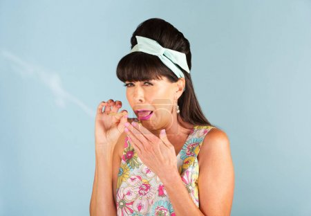 1950s woman coughing while smoking a joint