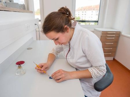 Female dental technician working in a dental lab
