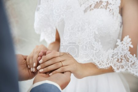 Bride and groom hands, closeup