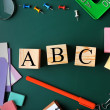 Composition of colourful stationery and word ABC o...