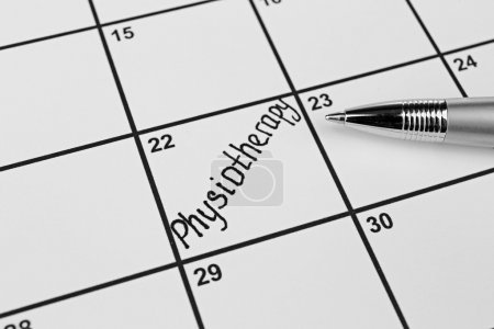 word PHYSIOTHERAPY on calendar planner