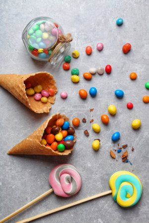 Photo for Dessert in ice cream cone on gray background - Royalty Free Image