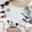 Flat lay of women cosmetics and accessories on whi...