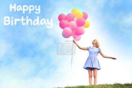 woman holding air balloons
