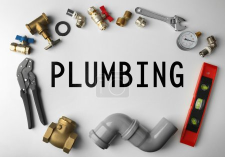 Plumbing concept. Plumber tools frame on white background