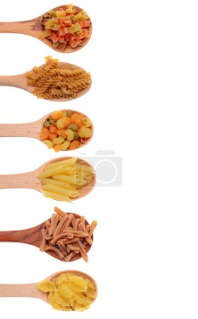 Pasta in wooden spoons isolated on white