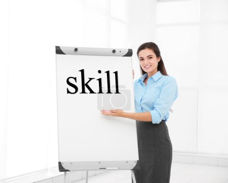 Skill. Business trainer giving presentation on whiteboard