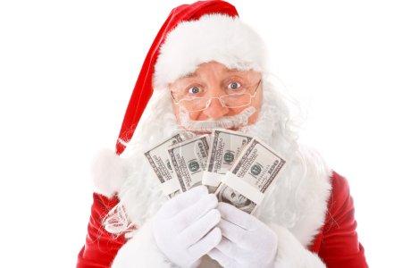Santa Claus holding money on white background