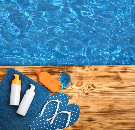 Summer beach set on swimming pool water background