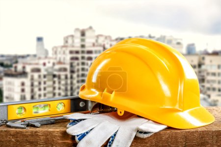 Construction tools and helmet on building construction background