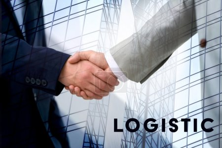 Logistics concept. Double exposure. Businessmen shaking hands and skyscraper background