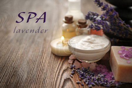 Spa composition and text SPA LAVENDER on wooden background.
