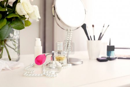 Perfume on light dressing table