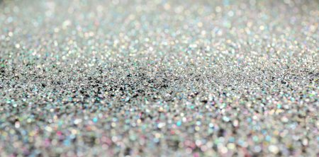 Glittering silver sparkles textured background