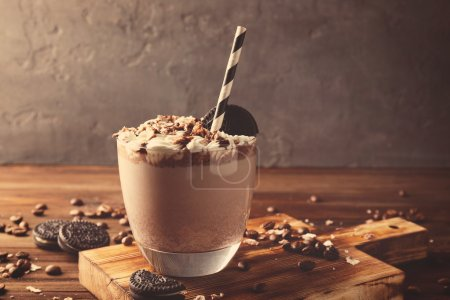 Photo for Delicious milkshake with chocolate, coffee and cookies on wooden background - Royalty Free Image