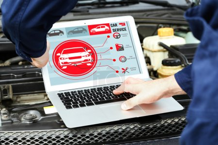 Photo for Mechanic with laptop near car engine. Modern car diagnostic program on screen. Car service concept. - Royalty Free Image