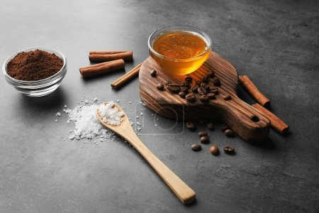 Natural ingredients for making facial mask on grey background