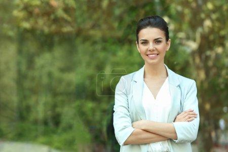 Beautiful businesswoman on window background