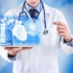 Cardiologist demonstrating virtual screen. Medicin...