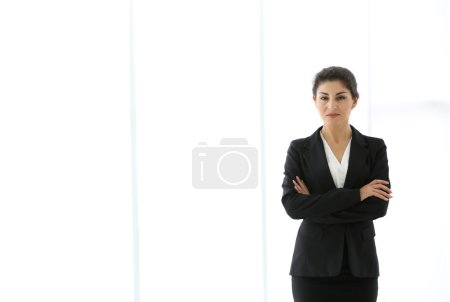 Successful mature businesswoman on light background