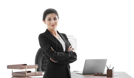 Successful mature businesswoman in her office