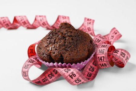 Chocolate muffin with centimeter