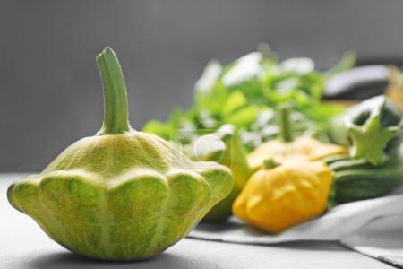 Fresh pattypan squash on table