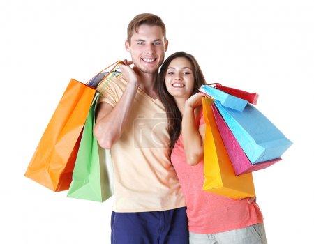 Photo pour Couple heureux avec des achats isolés sur blanc - image libre de droit