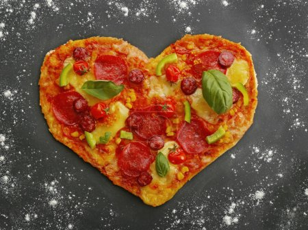 Tasty heart shaped pizza